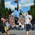 Basketball Players in Berlins Mauerpark with Crowd in Background - Hebstreits